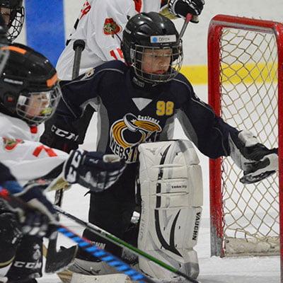 hockey goalie saving puck
